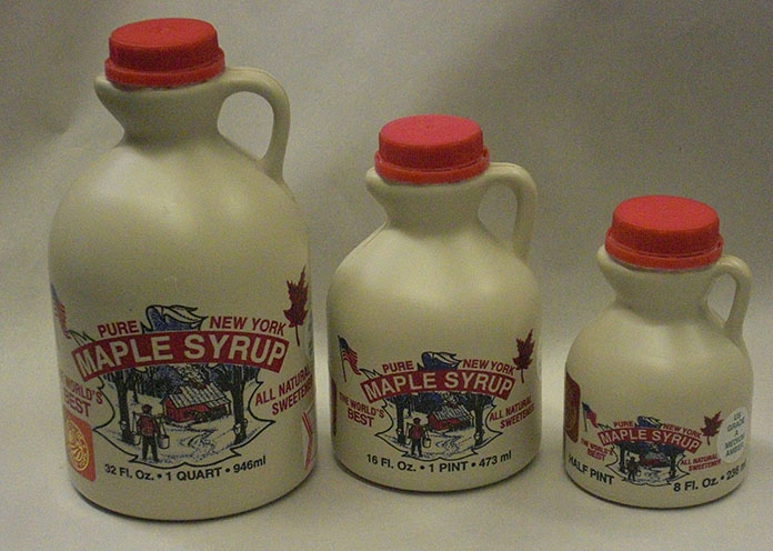 jugs of maple syrup
